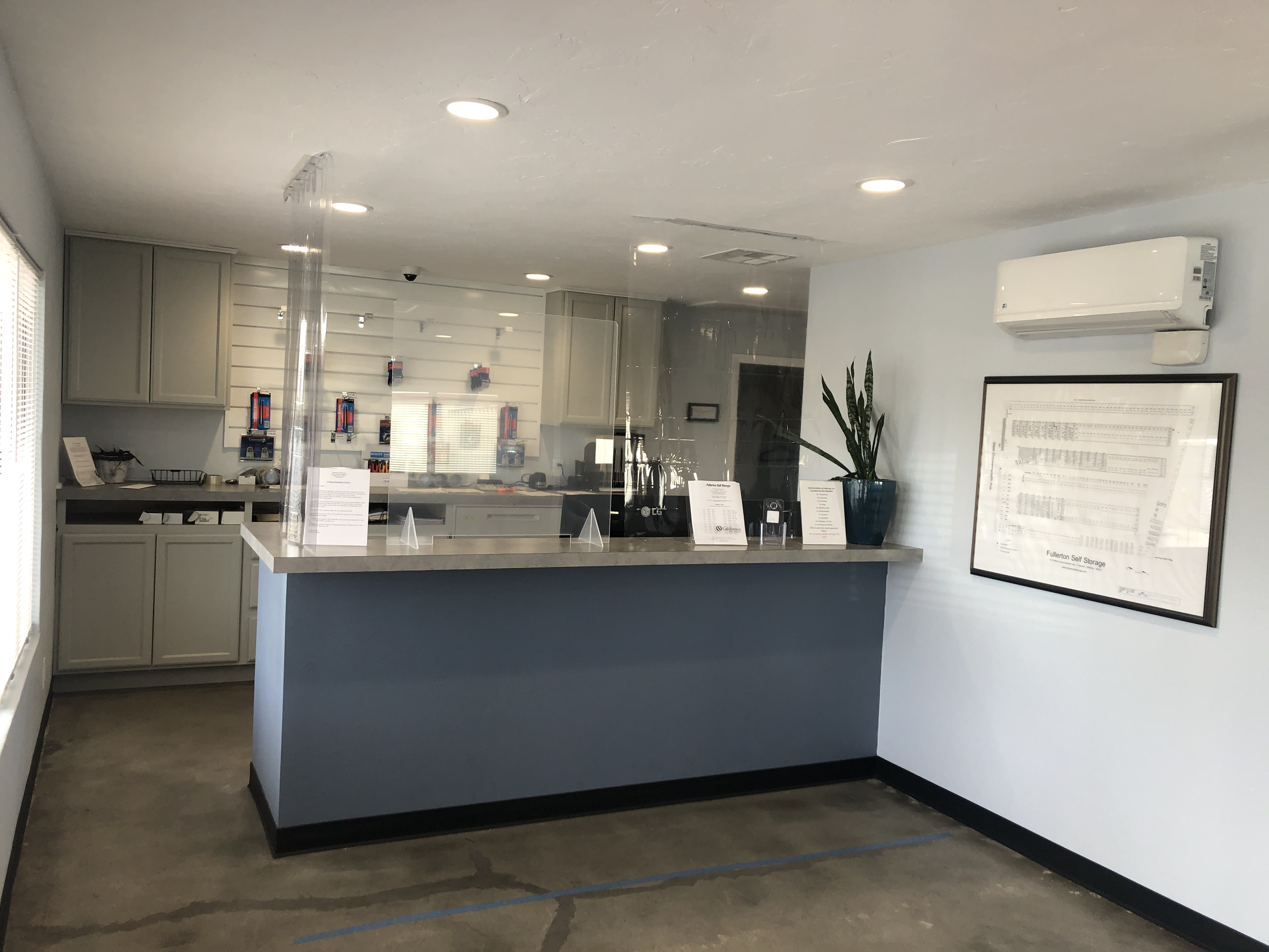 front office and desk with tall, clear plastic divider