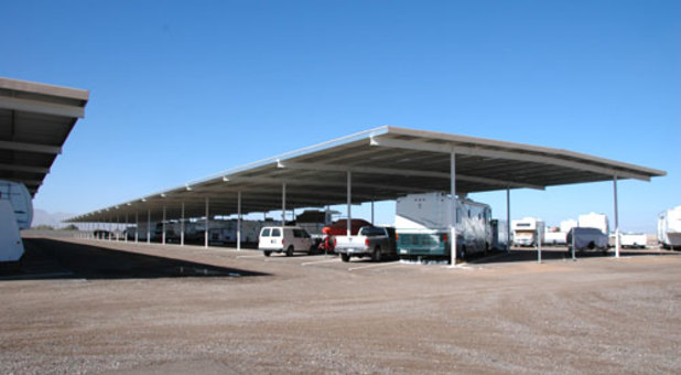 Row of parked RVs at Dysart RV and Boat Storage