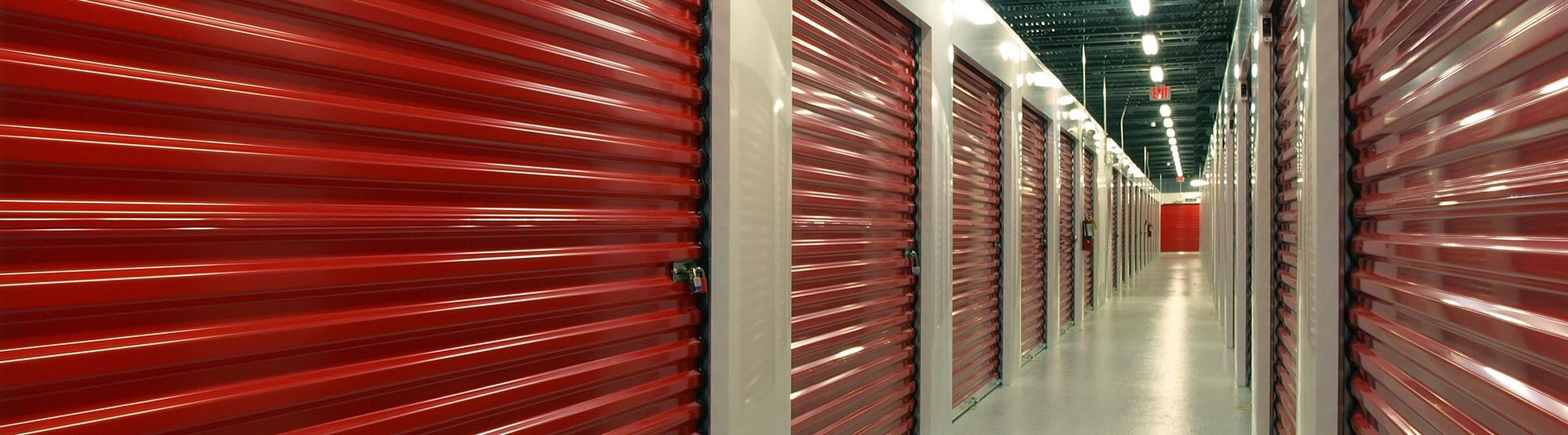 Row of red indoor American Personal Storage units