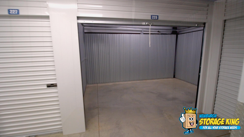 Interior storage unit with door open, unit is empty