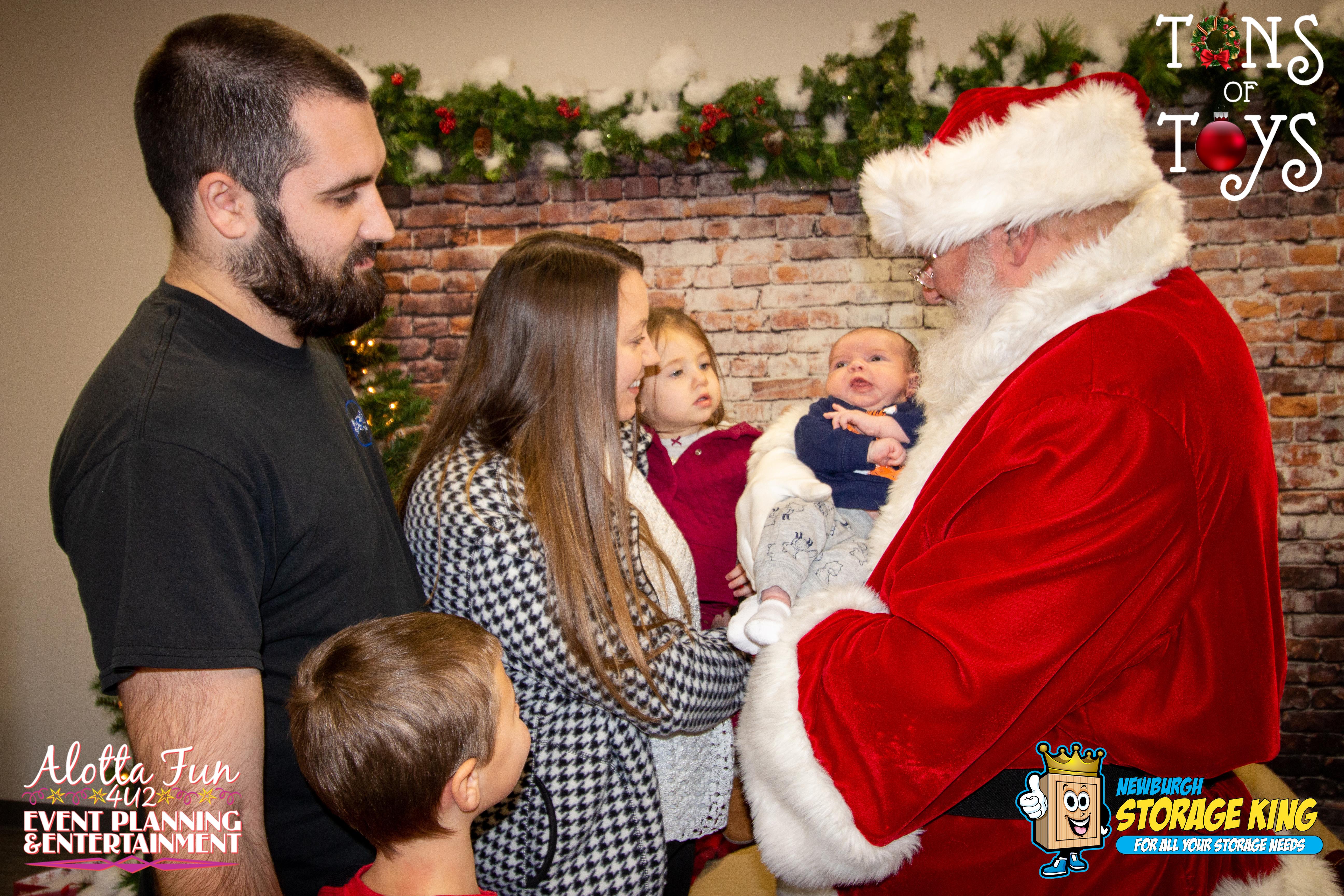 family gathered around santa