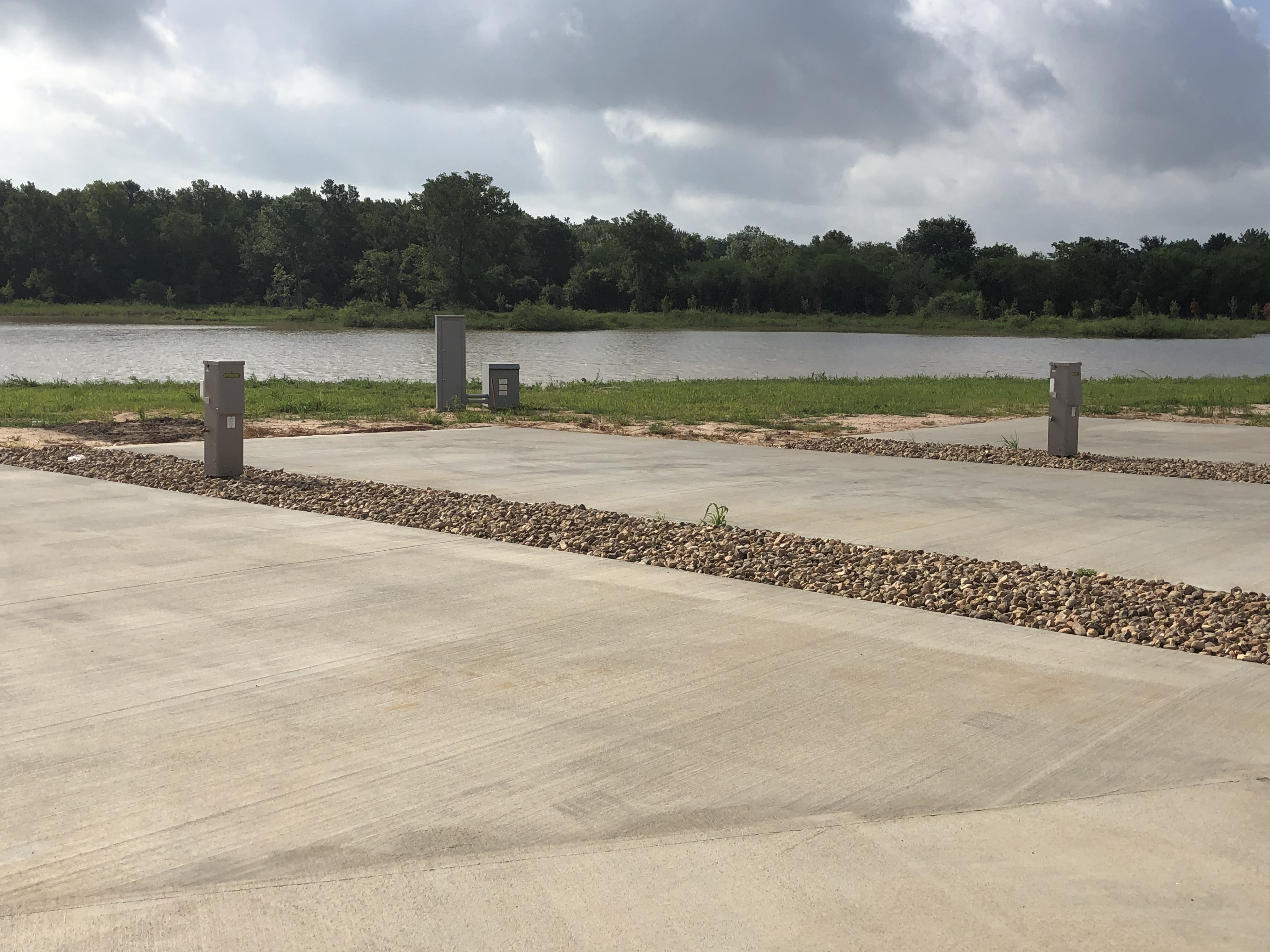 RV camping spaces overlooking the pond in Sealy, TX