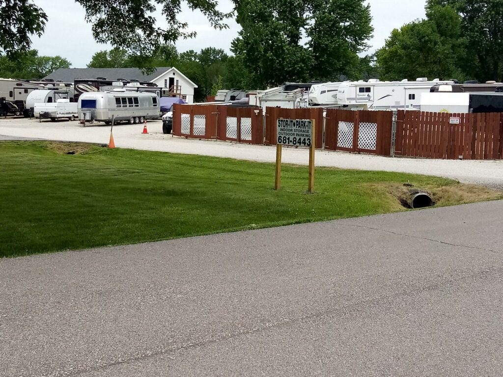 RVs parked in a fenced facility