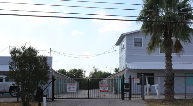 A Austin Storage security gate with storage facility behind