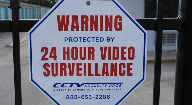 A Austin Storage 24 hours surveillance sign