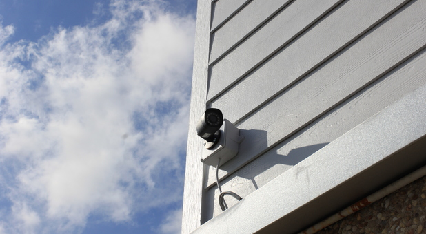 A Austin Storage security camera mounted to side of building