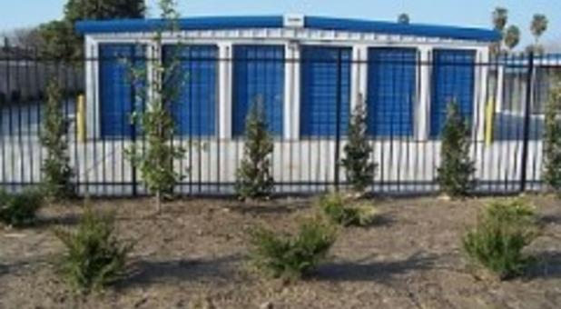 Self storage units behind gate in Bakersfield, CA