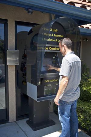 man using 24-hour kiosk