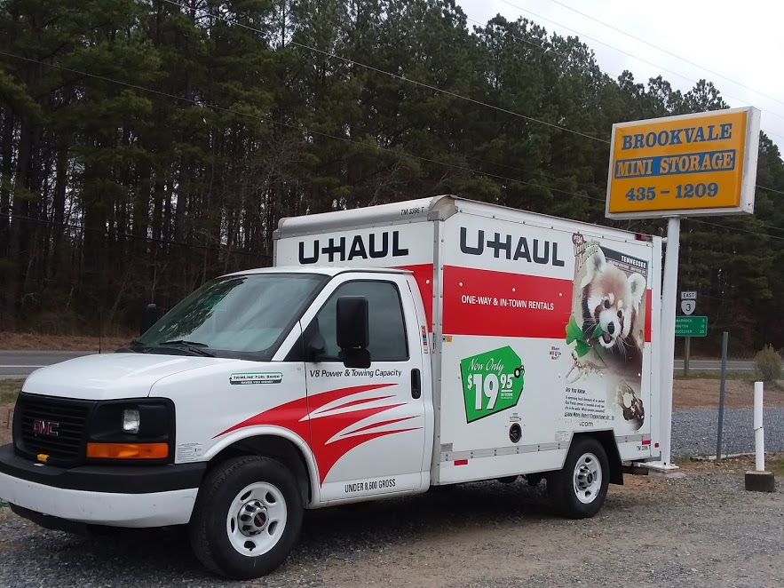 uhaul rental truck in front of storage facility sign in Lancaster, VA