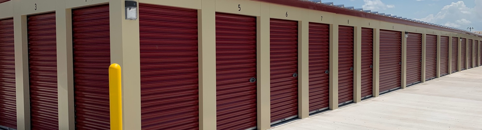Outdoor access storage unit with 5 foot wide doors, units on all sides of the building