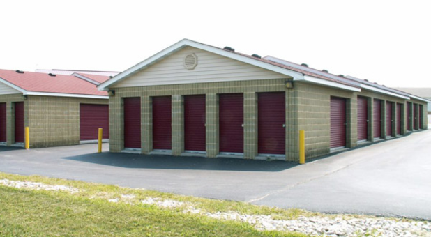 Storage unit building with exterior access doors