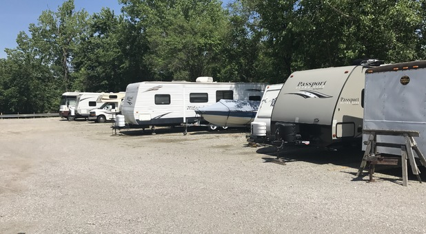 RVs parked in an uncovered lot