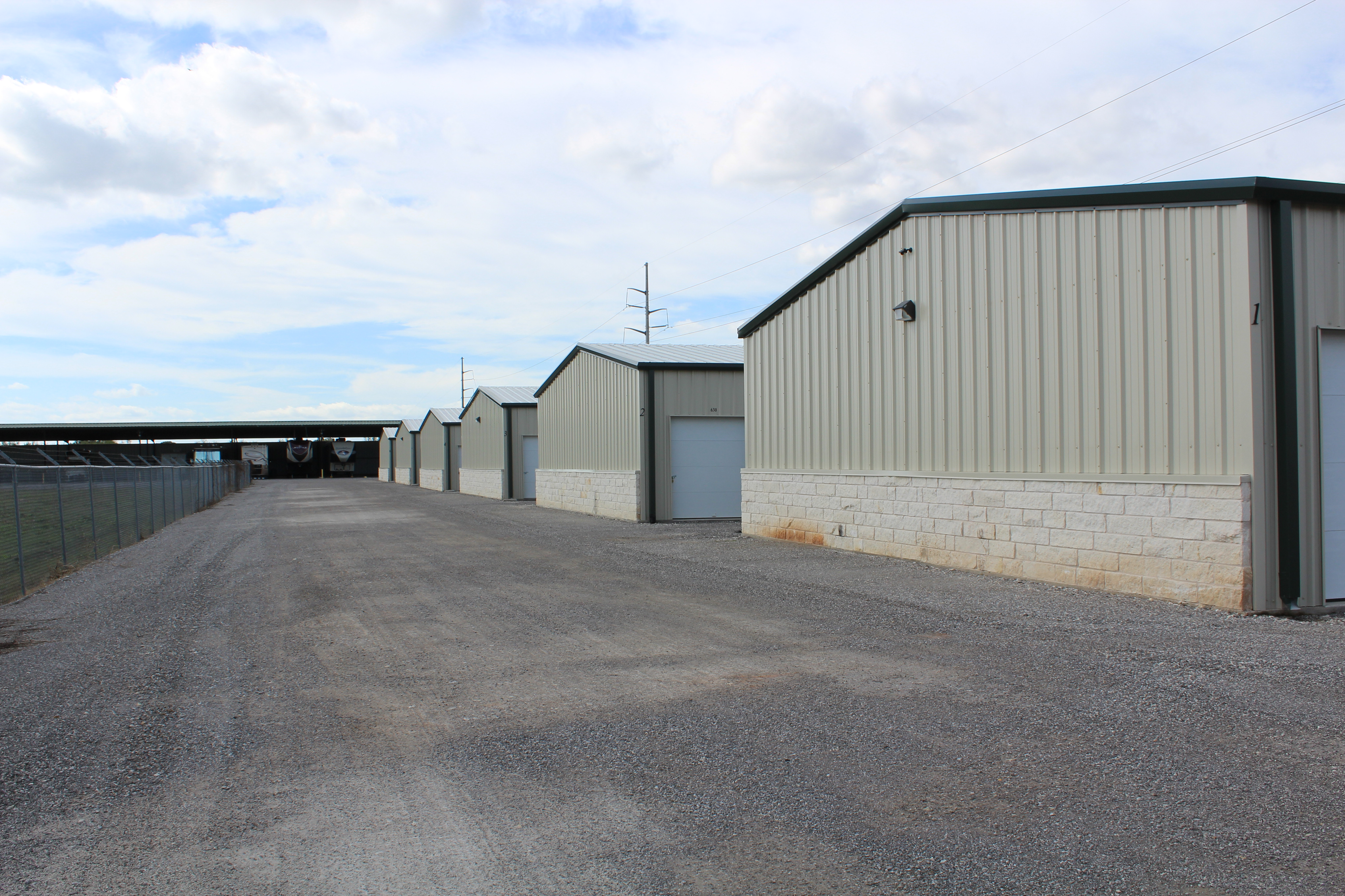 storage buildings with driving lane in acton, tx