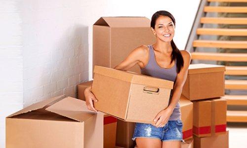 Woman holding storage boxes