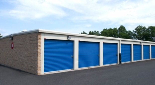 A1 Self Storage building with blue garage doors