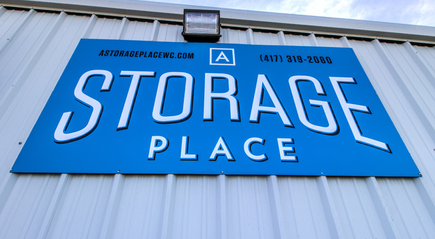 A Storage Place logo on wall