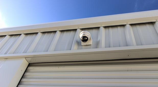 Security camera atop a self storage unit