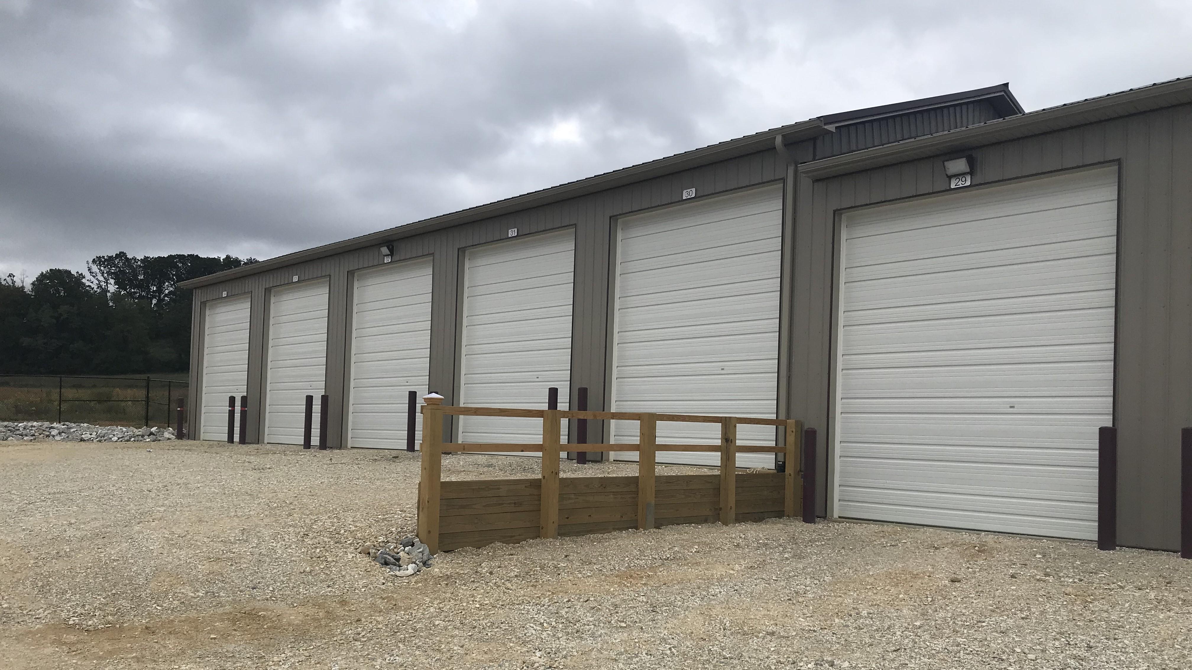 Vehicle storage units with large doors