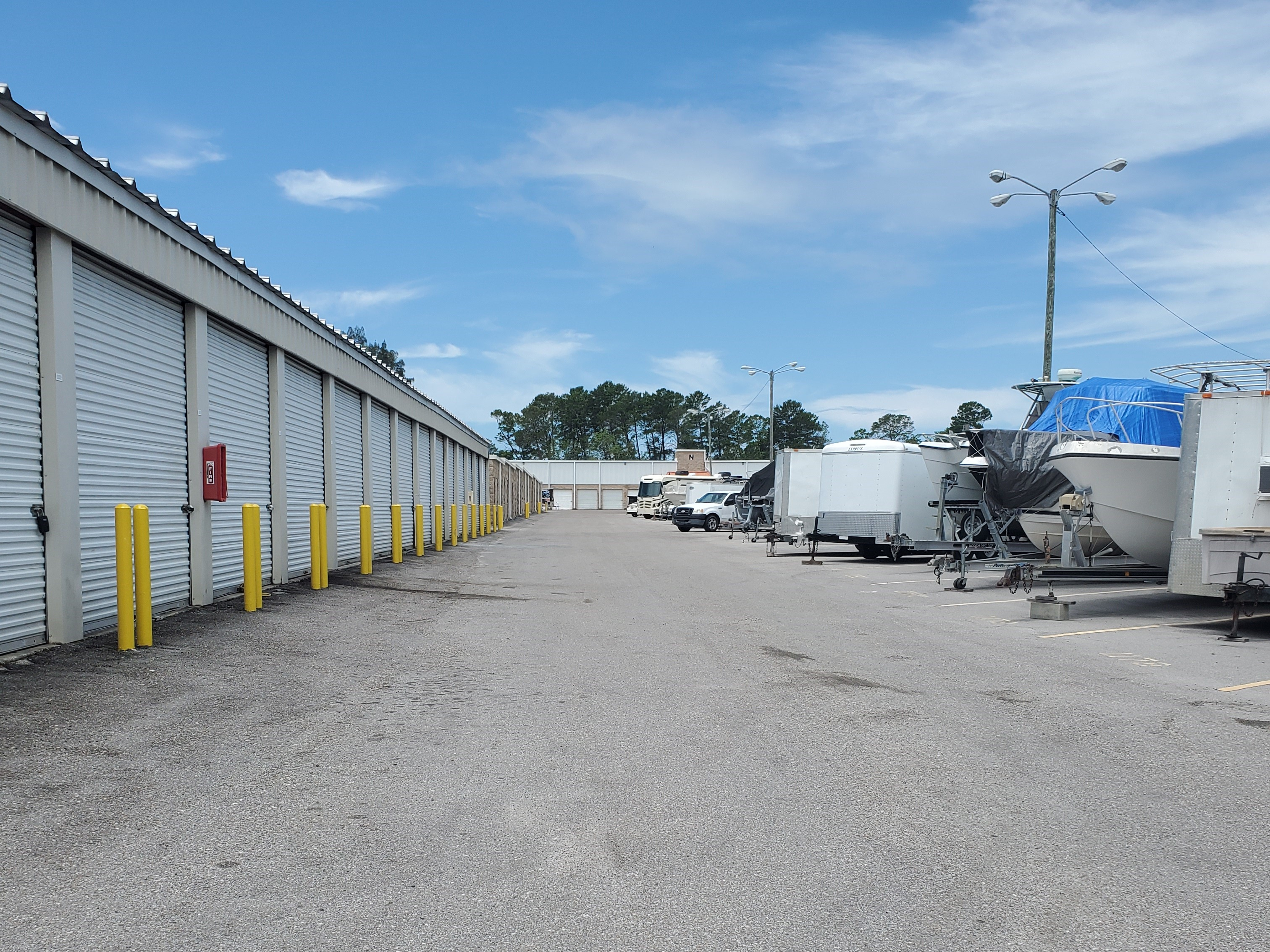 Row of storage spaces and parked RVs