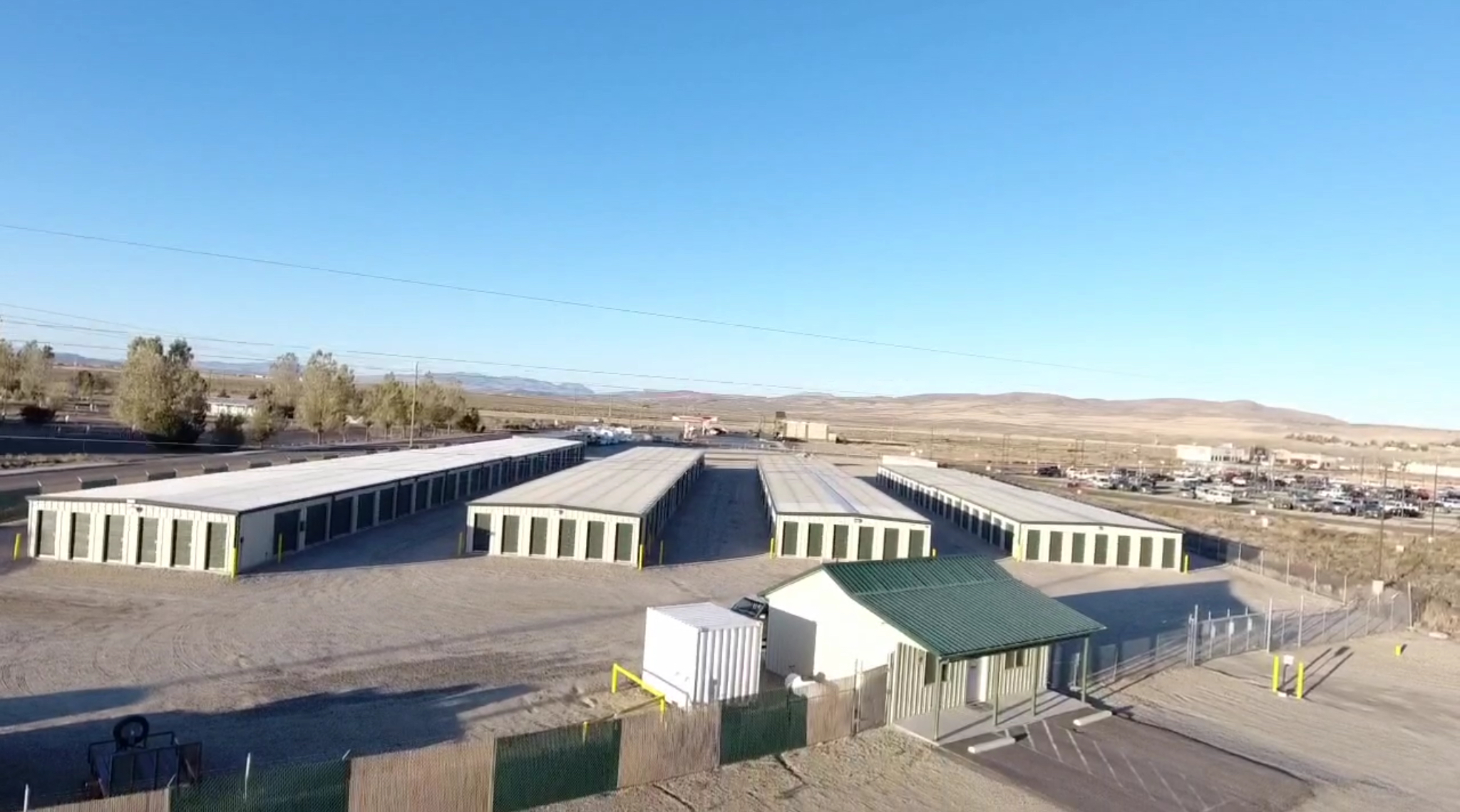 aeriel view of Spring Creek Self Storage. fenced and gated facility with multiple storage units