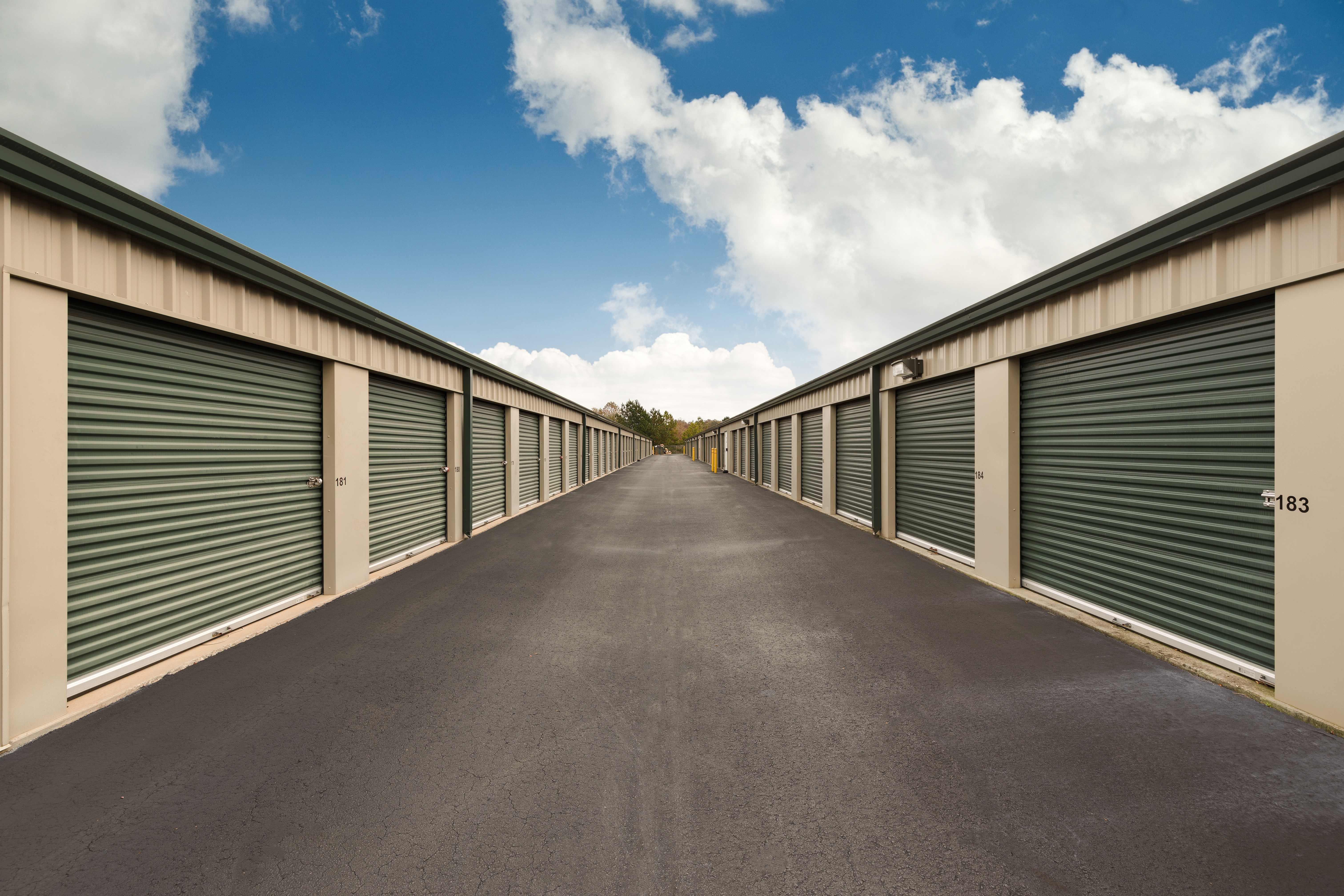two rows of storage units with a driving aisle in between