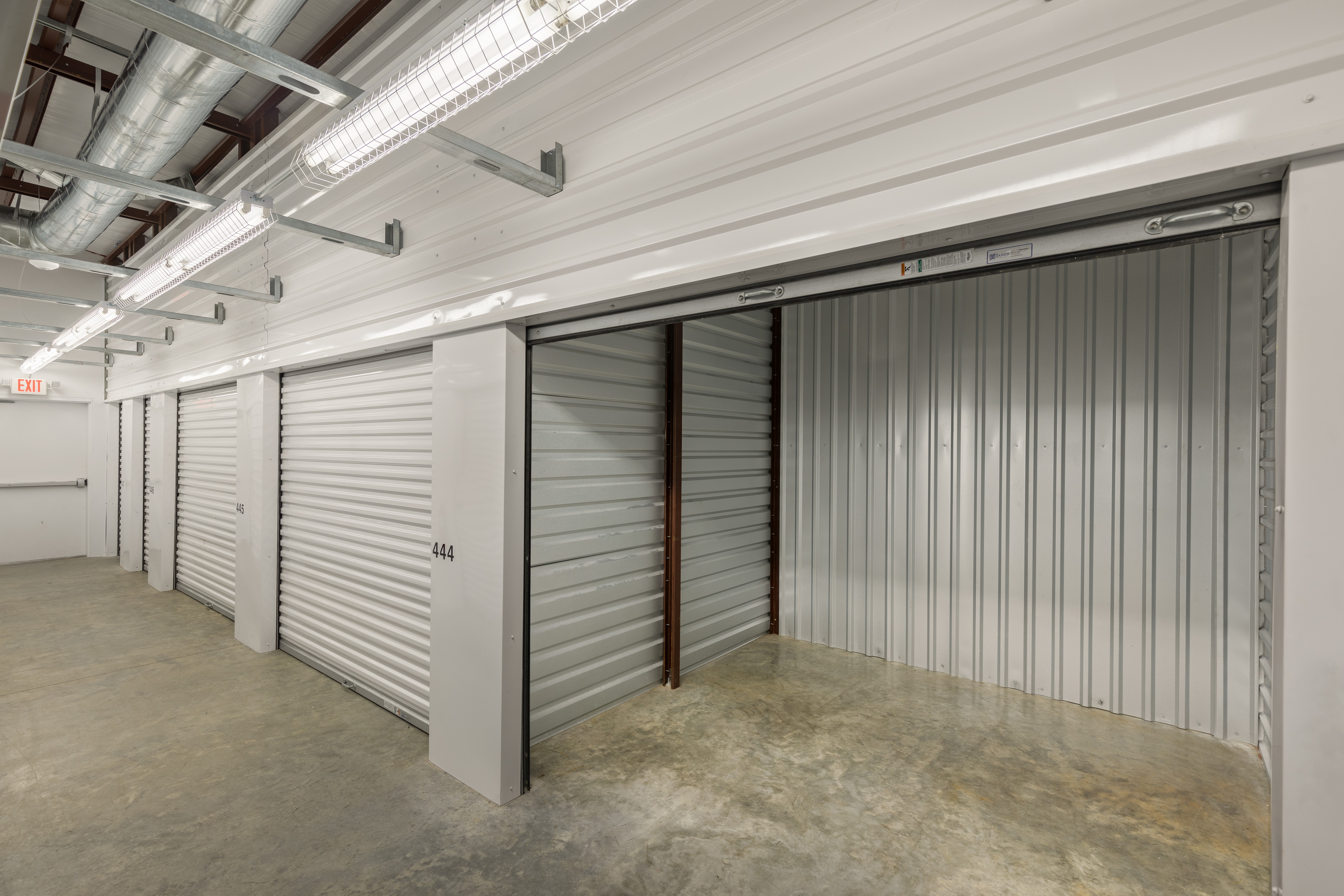interior storage units, one with roll up door open