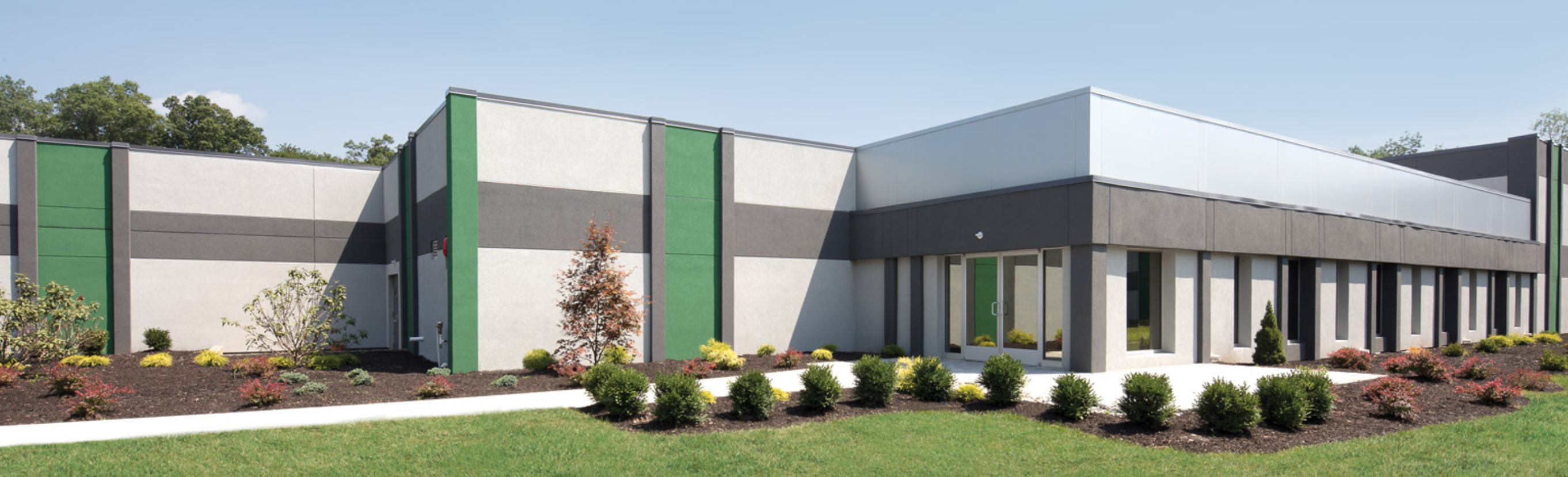 "digital rendering of self storage facility, multi level with window at building corner, sign reading ""columbia self storage"" on right side of the building"