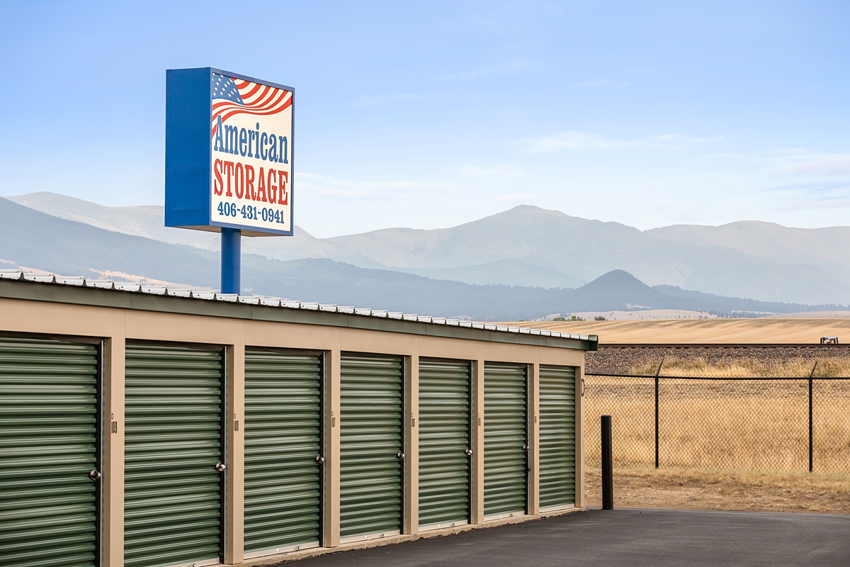 American Storage Sign above a storage building with drive up doors