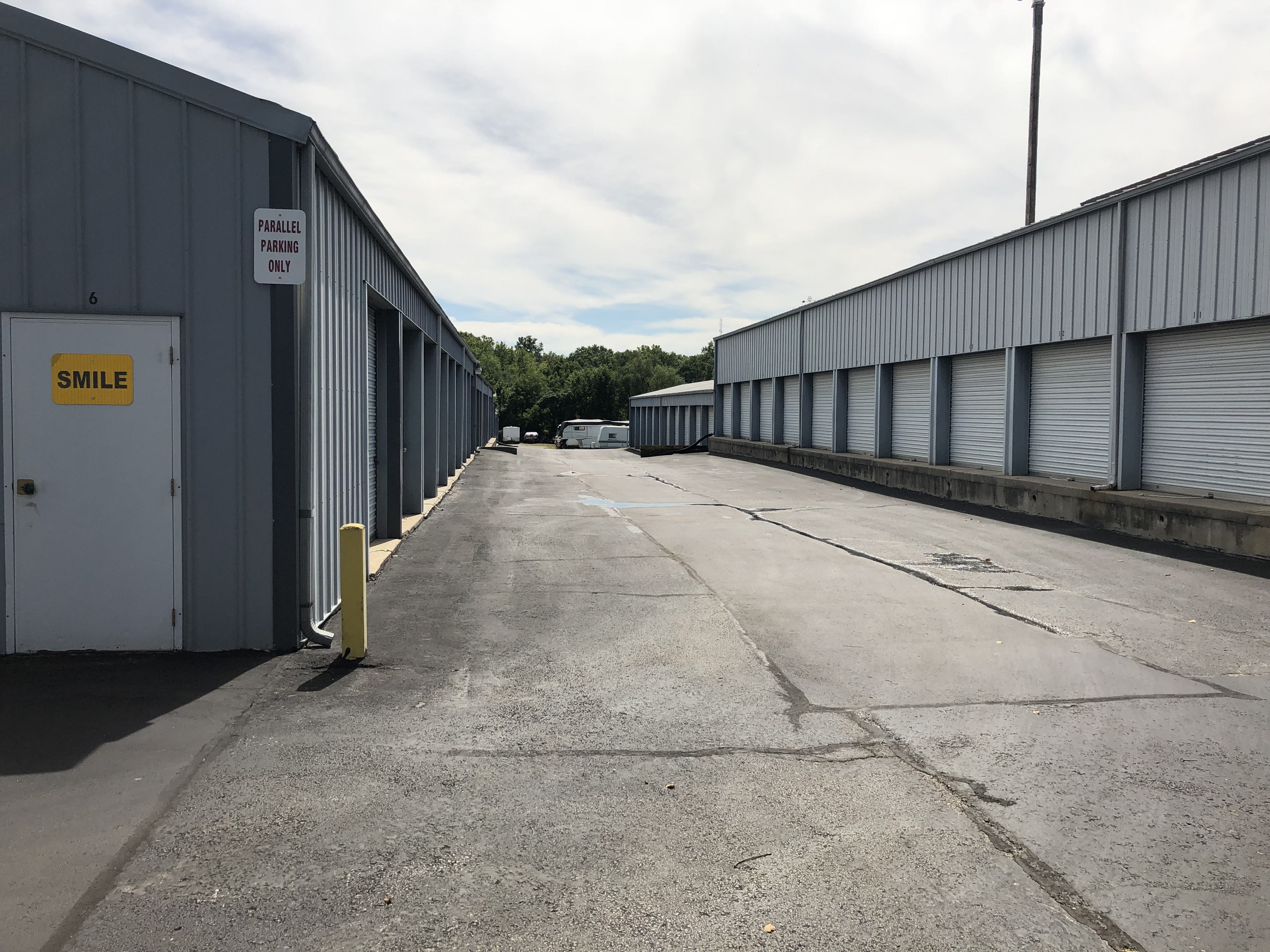 two storage buildings with roll up doors and drive up access