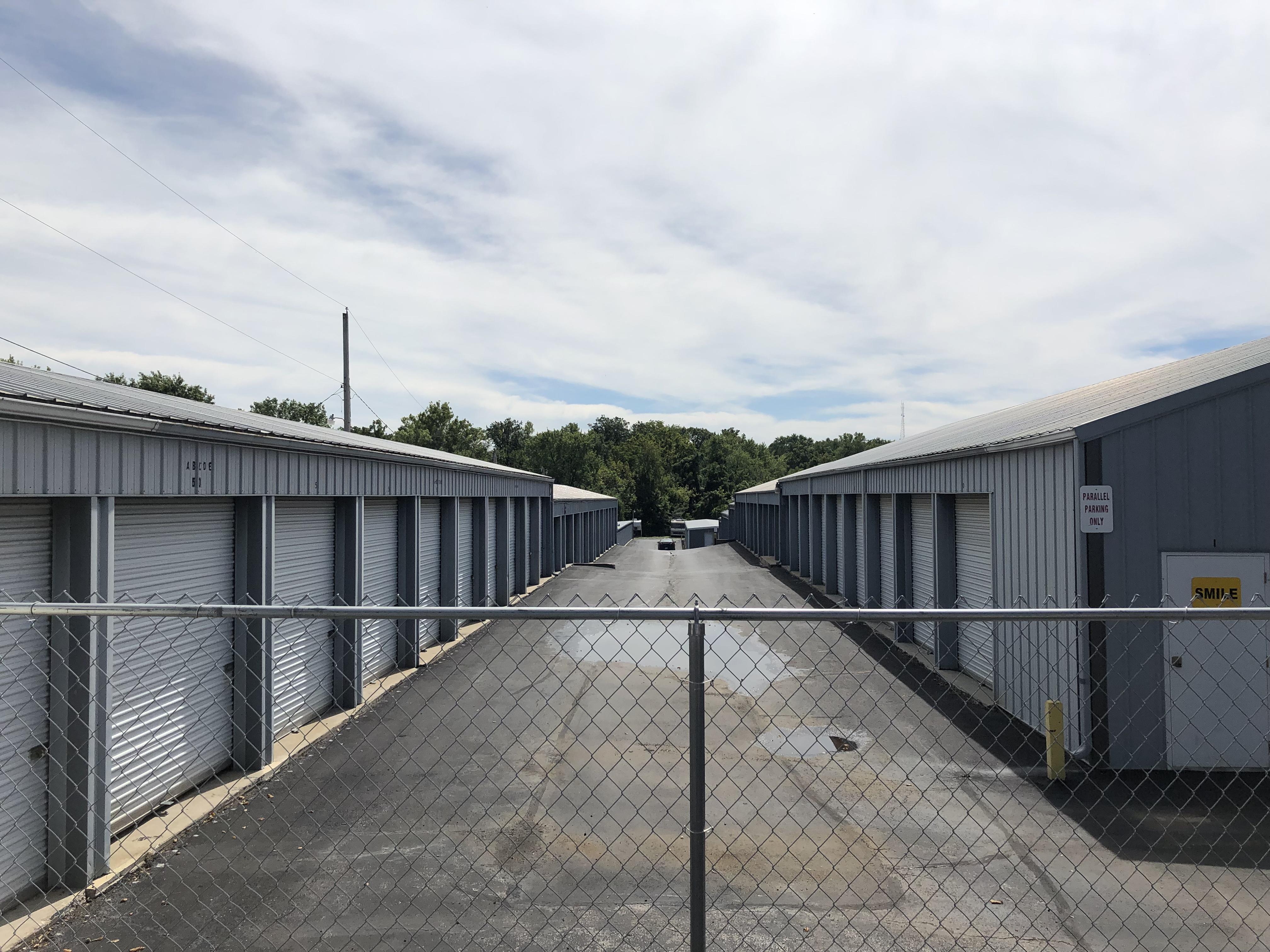 storage buildings behind perimeter fence