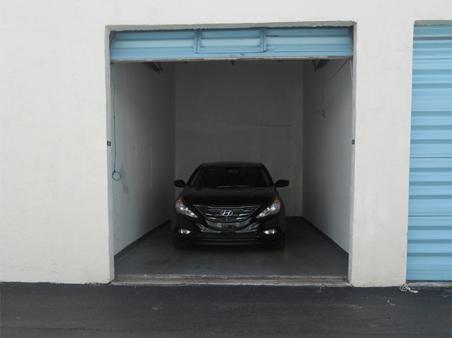 storage unit with car inside Miami, FL