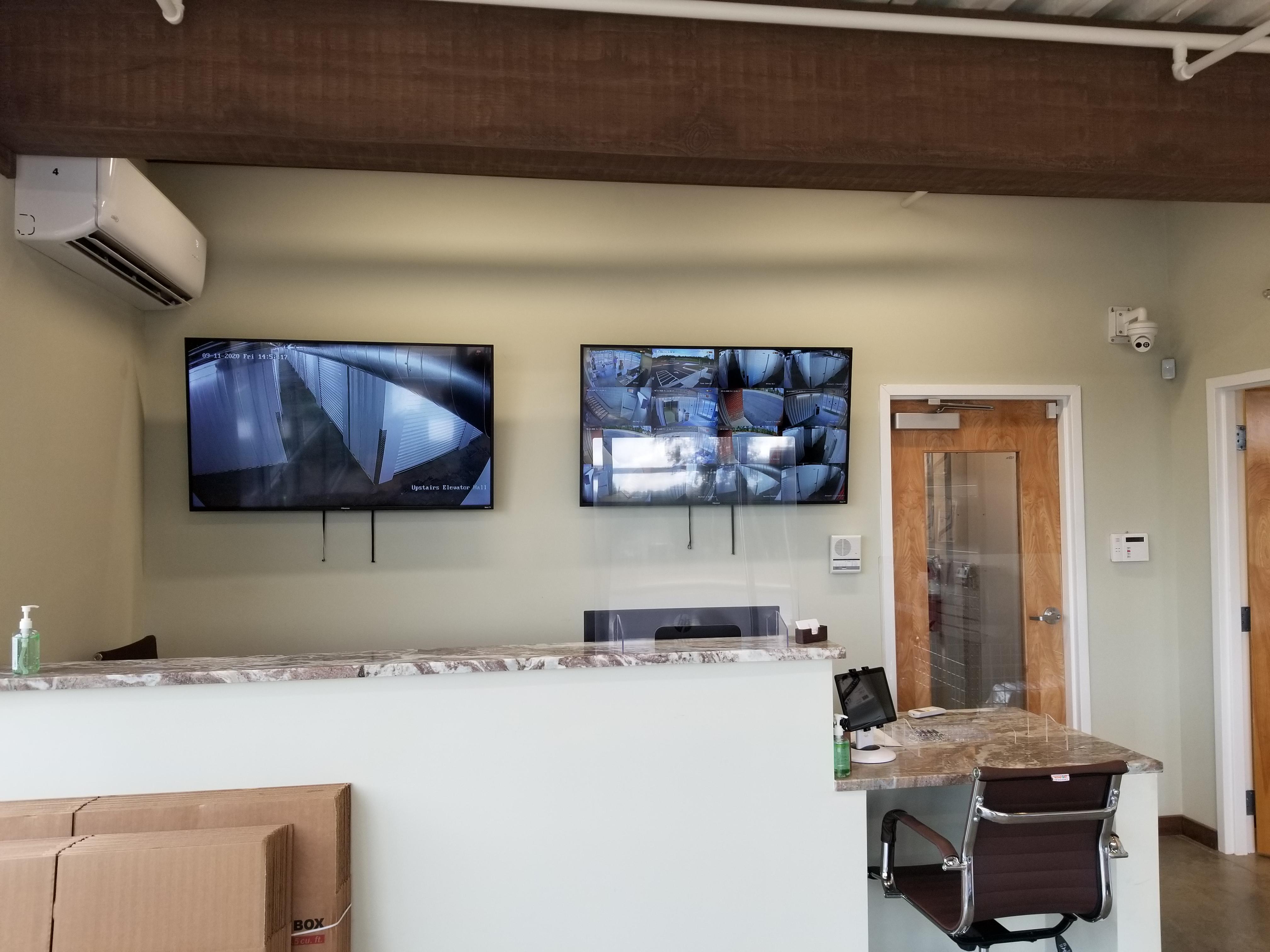 """Twin 55"""" TVS Displaying 16 Cameras"""