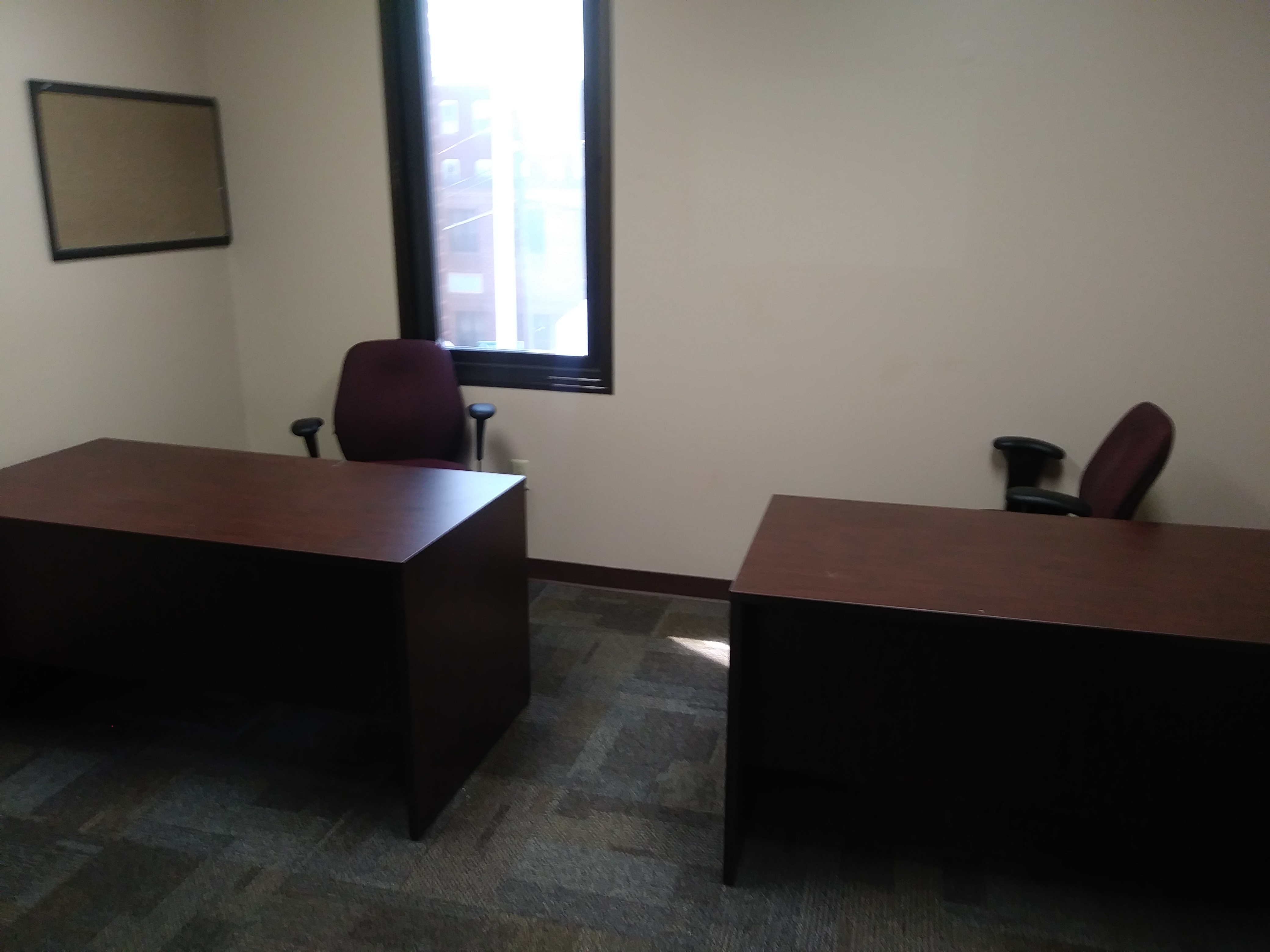 rental office space furnished with two desks and chairs