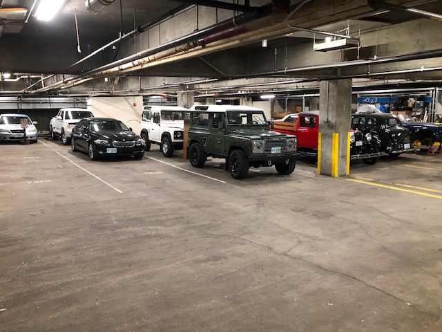 cars parked in covered parking storage lot