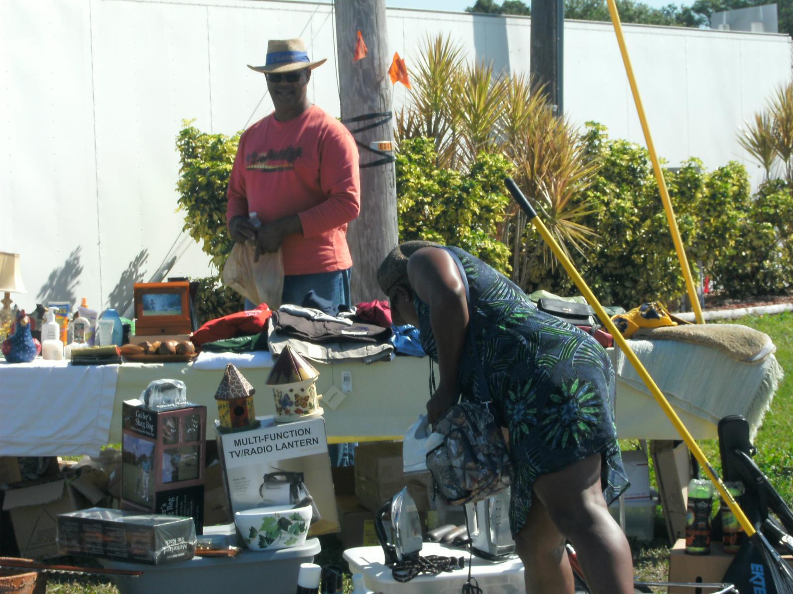 man with hat at yard sale Sarasota, FL