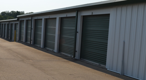 Self storage building with driving lane in front and drive up access doors. The doors face to the right