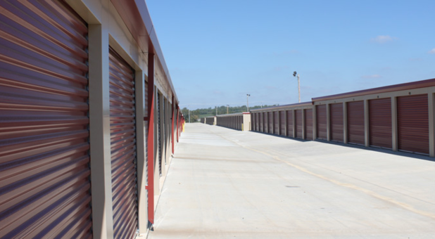 Two outside storage buildings with a wide driving lane between them
