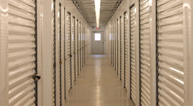 Hallway with storage units lining the walls on either side