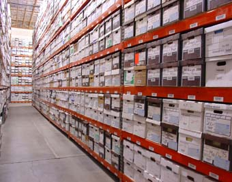 row of warehouse shelves with document boxes