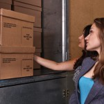 two people looking at stacked moving boxes