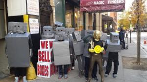people wearing cardboard box robot costumes
