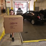 child unloading box from car in sofia storage centers loading bay