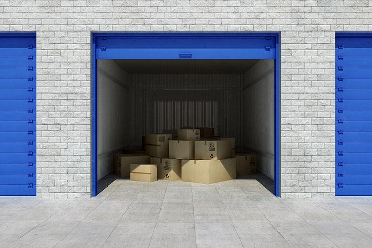 Cardboard boxes in a self storage unit.