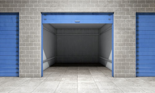 An open self storage unit with a blue door