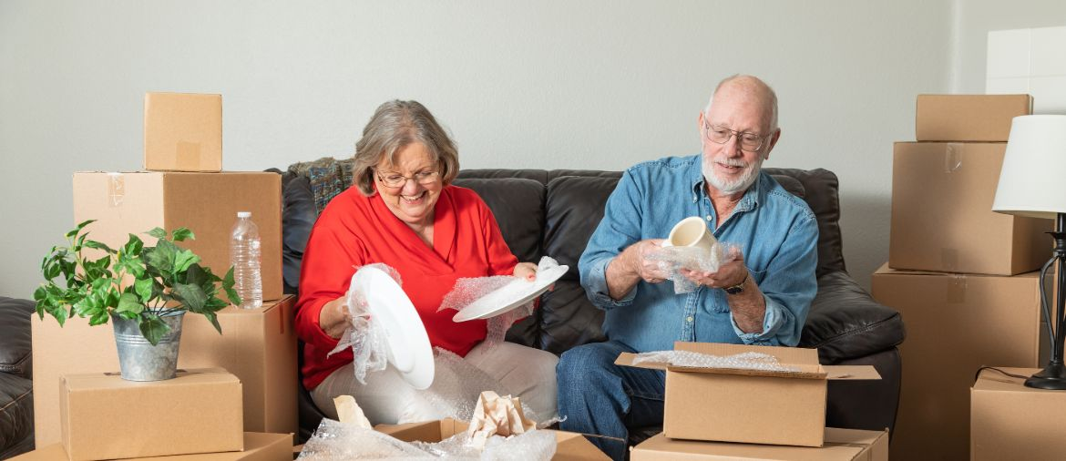 Couple Packing Dishes for Storage