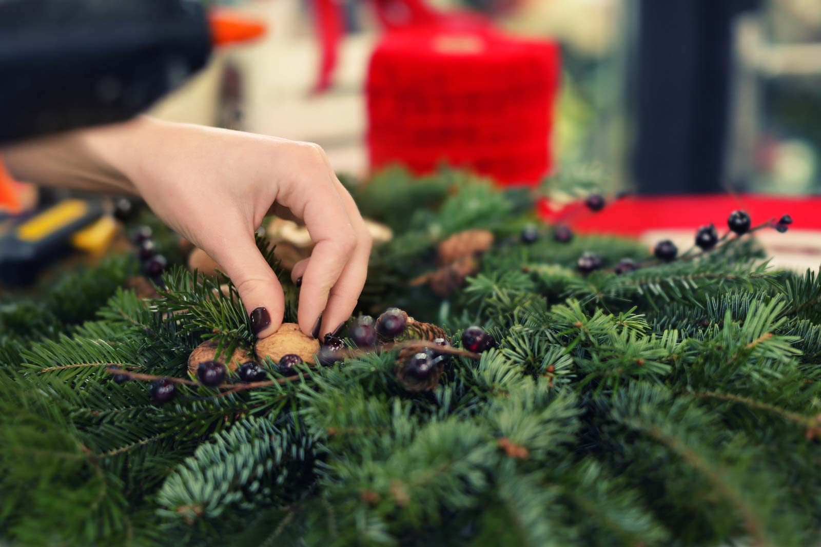 A woman prepares holiday decorations for self storage