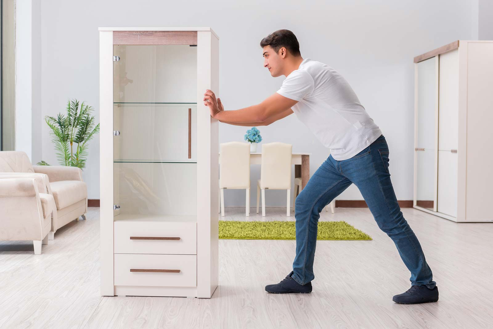 Man prepares to move a dresser to a self storage unit