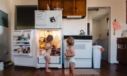 Kids at the refrigerator at a home