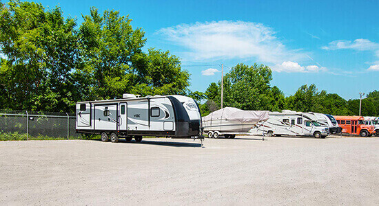 StorageMart RV or Boat Parking - Self Storage Units Near Merle Hay Rd, north of I-80 In Johnston, IA