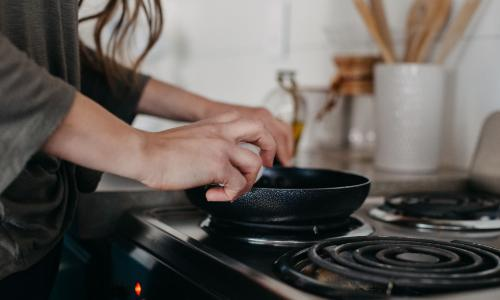 Woman at stove in home